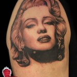 Shoulder Graphic Realistic Face tattoo by Piranha Tattoo Supplies