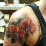 Shoulder Realistic Flowers tattoo by Bloodlines Gallery