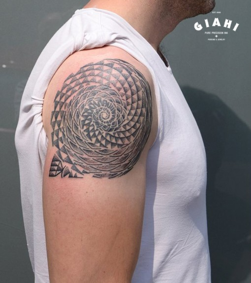 Shoulder Triangle Whirlpool Dotwork tattoo by Andy Cryztalz
