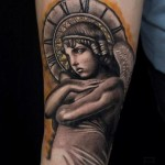 Time Angel Graphic tattoo by Mumia Tattoo