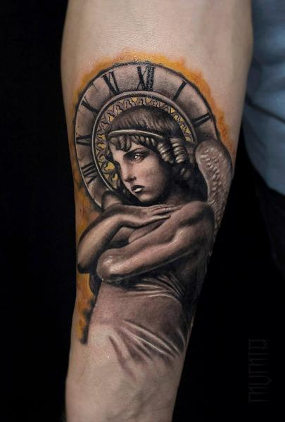 Time Angel Graphic tattoo by Mumia Tattoo