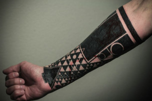 Triangles and Circles Blackwork tattoo on Arm