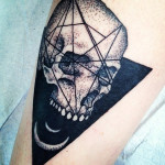 Two Moons Skull Blackwork tattoo