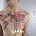 World Map tattoo on Chest by Carola Deutsch