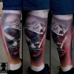 Abstract Faces Leg tattoo