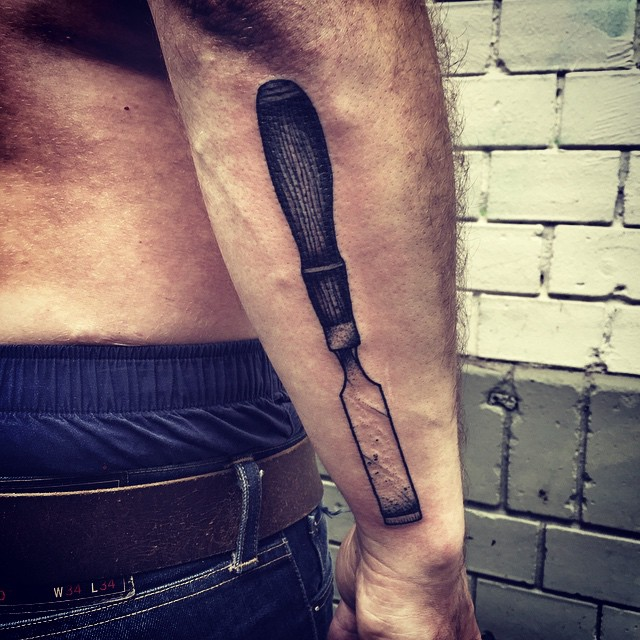 Arm Chisel tattoo