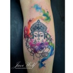 Beautiful Watercolor Ganesha Arm tattoo by Javi Wolf