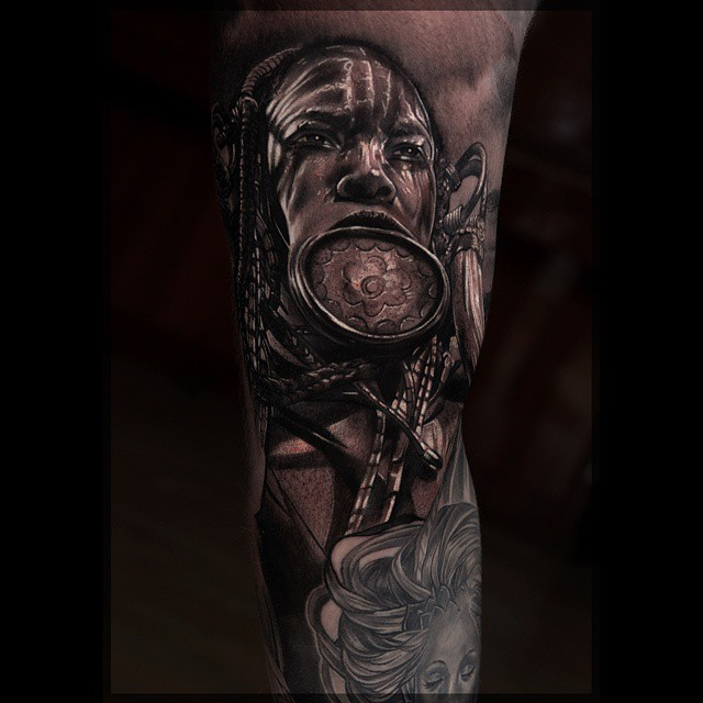 Realism Tattoo For Woman: Black & Grey Realistic Tribe Woman Tattoo By Pavel Roch