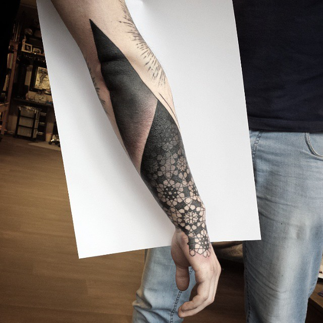 Blacwork tattoo sleeve by Rudolf Tattooer From Space