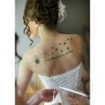 Blowball Back Lettering tattoo