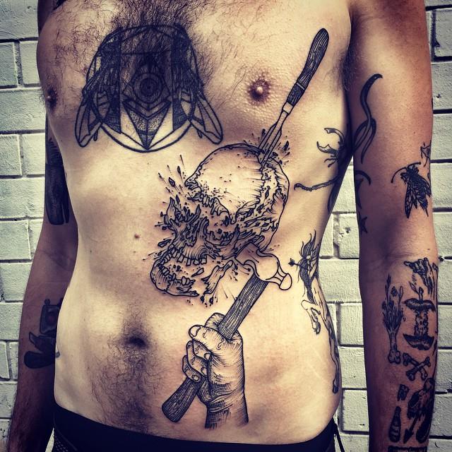Crushed Skull Stomach Tattoo