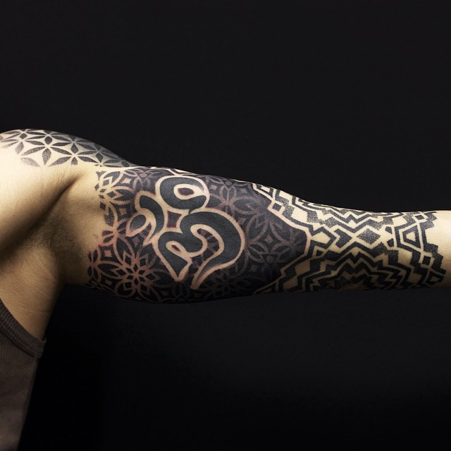 Hindu Symbol Arm tattoo