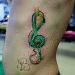 Pixel Snake Treble Clef tattoo