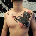 Raven Trash Polka Chest tattoo
