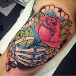 Rose in Skeleton Hand tattoo by Jack GOKS Pearce