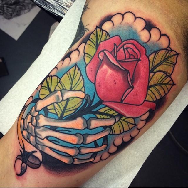 Rose in Skeleton Hand tattoo by Jack GOKS Pearce
