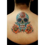 Smiling Chicano Skull tattoo on Back