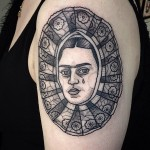 Stained-Glass Face Tear Shoulder tattoo