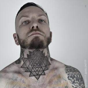 Triangles Dotwork Neck tattoo by Maxime Buchi
