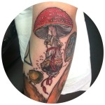 Arm Amanita tattoo