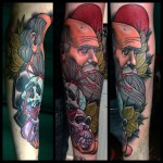Darwin with Skulls Arm tattoo