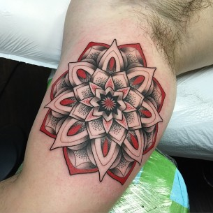 Black and Red Mandala Flower tattoo on Biceps