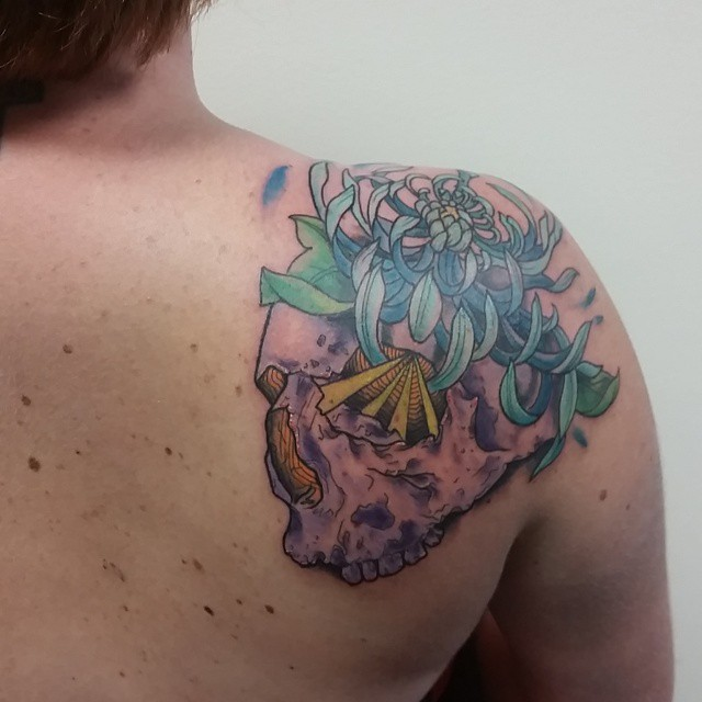 Blue Flower Pink Skull tattoo