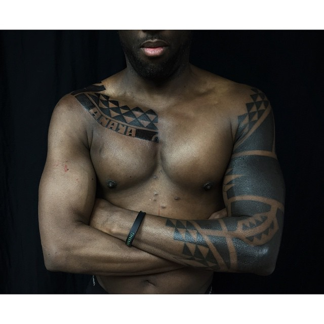 Chest and Sleeve Tirangles Blackwork tattoo