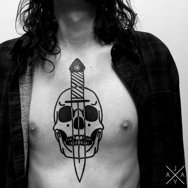 Dagger Through Skull tattoo on Chest