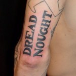 Dread Nought Lettering tattoo on Arm