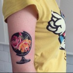 Fower Globe tattoo on Arm