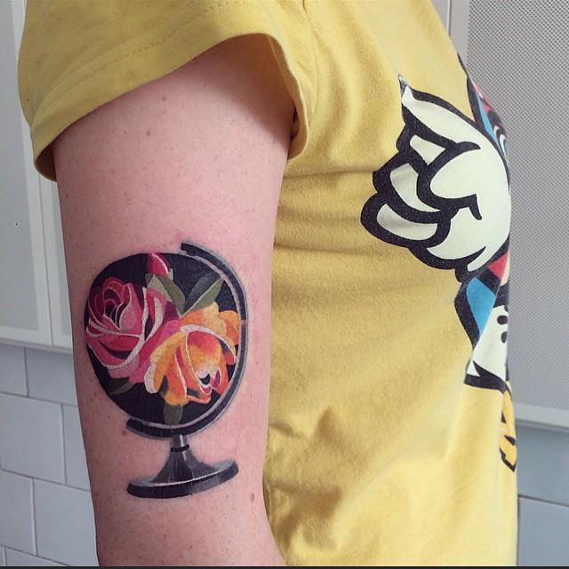 Fower Globe tattoo on Arm