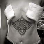 Girl Mehendi Tattoo on Stomach