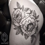 Graphic Flower Etching tattoo on Hip