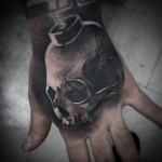 Graphic Skull Bomb Hand tattoo