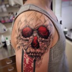 Grey and Red Skull on Shoulder