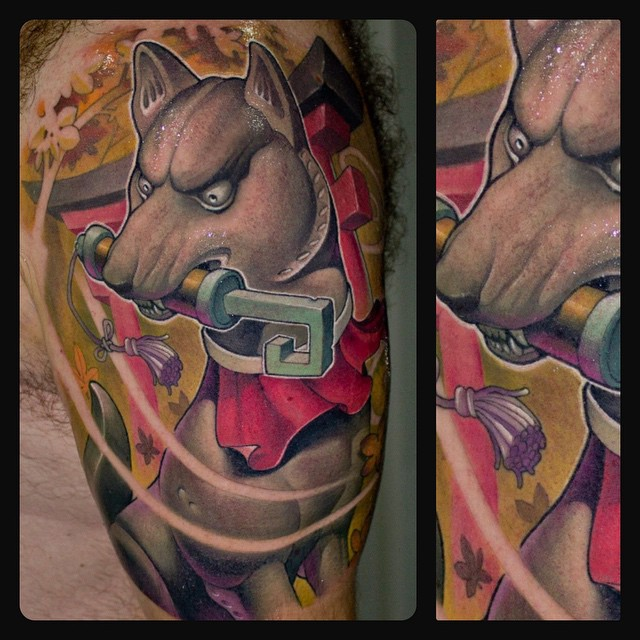 Hook in Teeth Dog tattoo