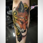 Jewelery Fox tattoo on Arm