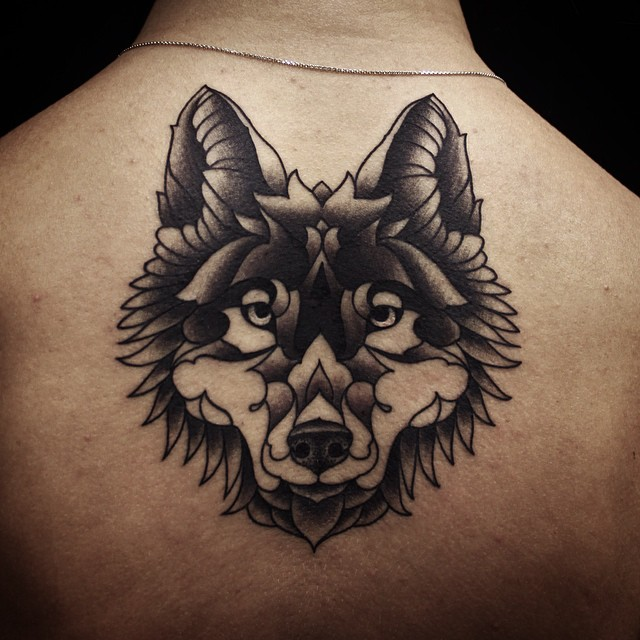 Lower Neck Wolf tattoo