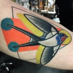 Orange Swallow Arm tattoo