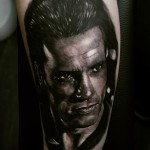 Realistic Arnold Schwarzenegger tattoo