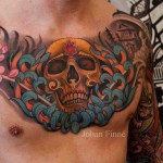 Ruby Forehead Skull Chest tattoo
