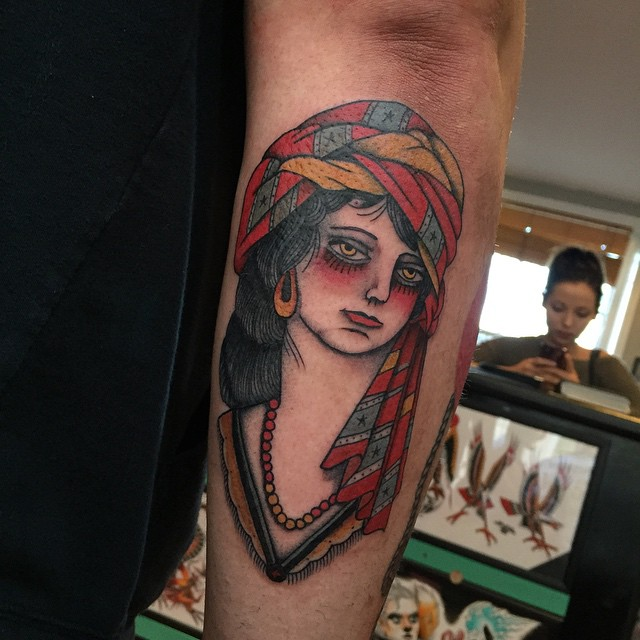 Sad Gipsy tattoo on Arm