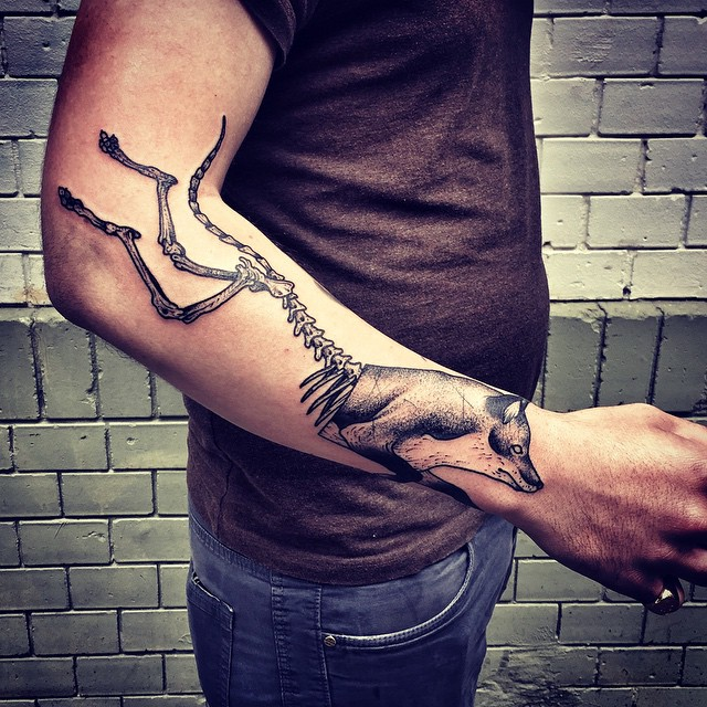 Skeleton Back Wolf Arm tattoo