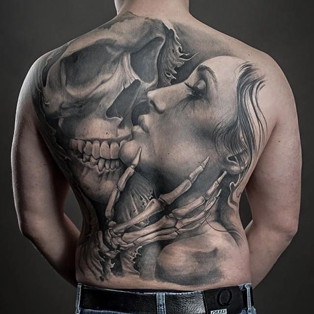 Skeleton Kiss Back tattoo