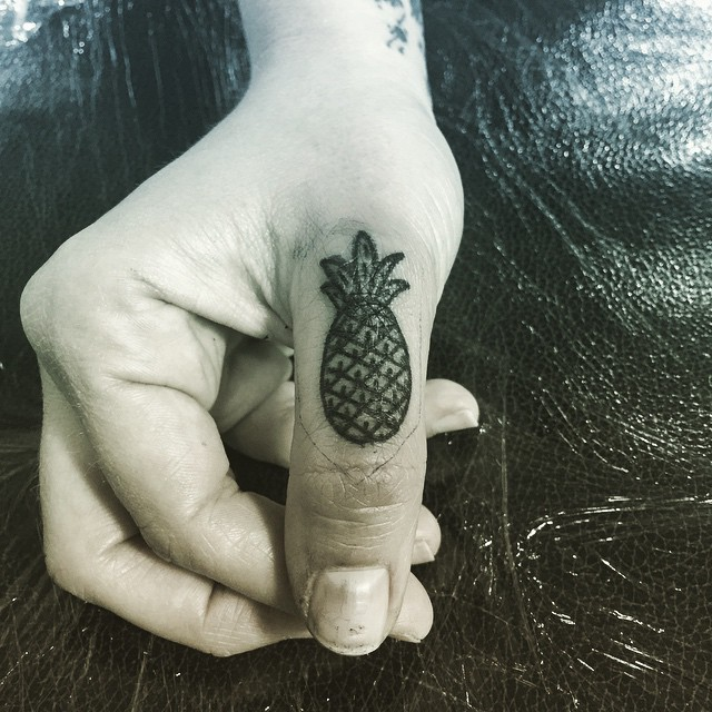 Small Pineapple Finger tattoo