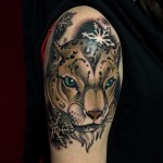 Snow Leopard tattoo on Shoulder