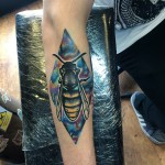 Space Bee tattoo on Arm