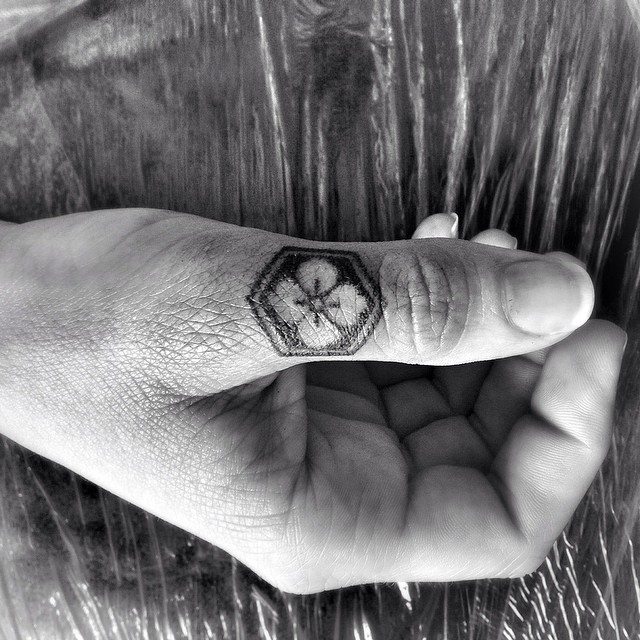 Thumb Finger Trefoil tattoo