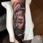 Trash Realistic Man Arm tattoo